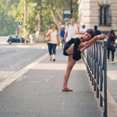 Young beautiful ballerina dancing along the street in Rome, Ital