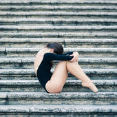 Young beautiful ballerina posing on the Spanish Steps in Rome, Italy