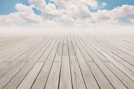 Photo for Cloudy blue sky and wood floor, background image. - Royalty Free Image