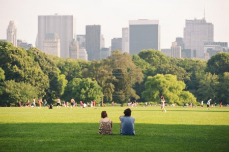enjoying relaxing outdoors in Central Park in New York.