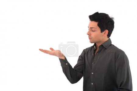 Young man showing hand with blank space where you can place your message