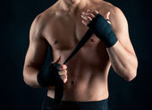 Sportsman boxer intense studio portrait against black background