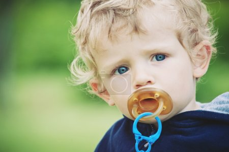 Small kid portrait with pacifier