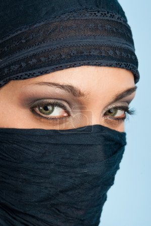 Portrait of veiled woman, focus on eyes