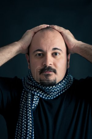 Photo for Man portrait with frustrated expression on dark background - Royalty Free Image