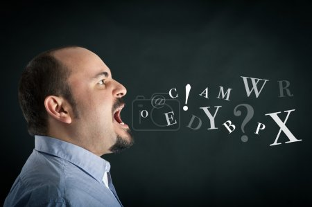 Angry man shouting against black background with letters coming from his mouth