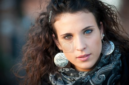 Photo for Close-up portrait of a beautiful girl at sunset. Natural different eyes color - Royalty Free Image