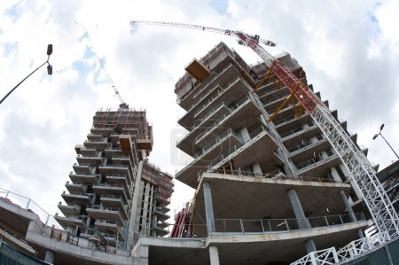 Building under construction in a new residential area of Milan, Italy