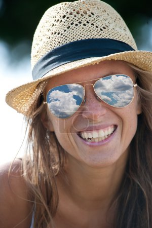 Young beautiful woman portrait with straw hat and sunglasses