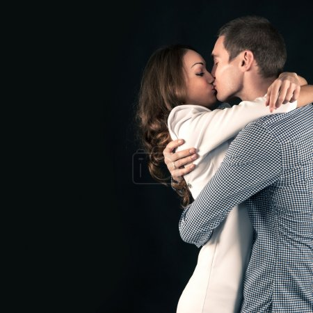 Photo for Studio portrait of attractive young couple on black background - Royalty Free Image