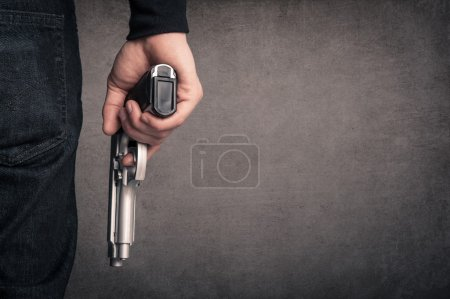 Killer with gun close up over grunge background wi...