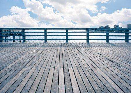 Empty pier at Coney Island beach, New York City....