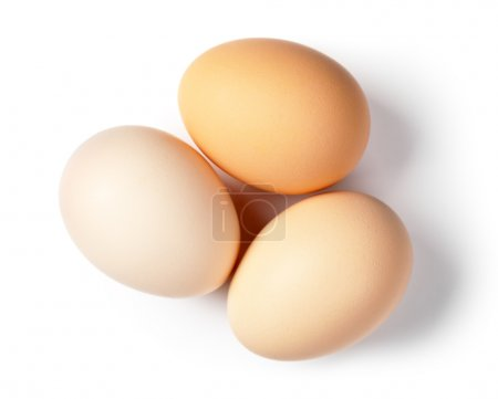 Photo for Three eggs on white background. Top view - Royalty Free Image