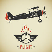 Retro flat looking plane and emblem with wings flame and propeller