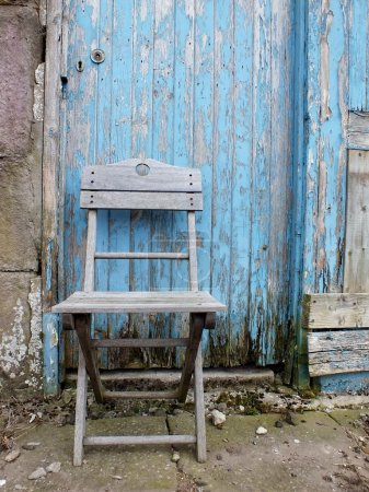 Photo for Shabby chic wooden chair with blue weathered grunge background - Royalty Free Image