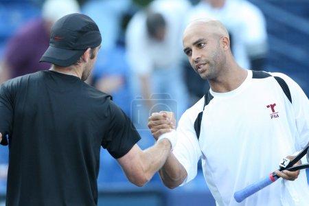 Benjamin Becker and James Blake play a match