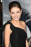 Mila Kunis attends The Book of Eli premiere
