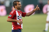 Rodolfo Espinoza gives his teammates a thumbs up during the game