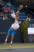 Jack Sock practices his serve against Flavio Cipolla during the tennis match