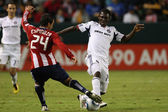 Patrick Nyarko and Rodolfo Espinoza in action during the game