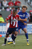 Rodolfo Espinoza and Kansas City Wizards defender Michael Harrington in action during the game