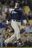 ADRIAN GONZALEZ takes a swing during the game