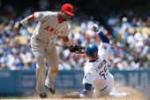 Russell Martin steals second and tries to beat the tag by Erick Aybar during the match