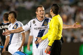 Chad Barrett argues with the referee after his teammate got red carded during the Major League Soccer game