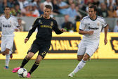 David Beckham and Gonzalo Higuain in action during the World Football Challenge game