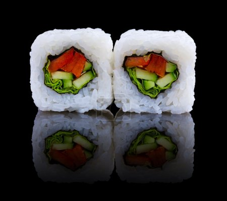 Photo for Sushi with cucumber and pepper on black - Royalty Free Image