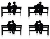 Different silhouettes of couples on benches