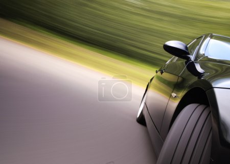 Photo for Front Side view of black sedan in Turn with Motion Blur - Royalty Free Image