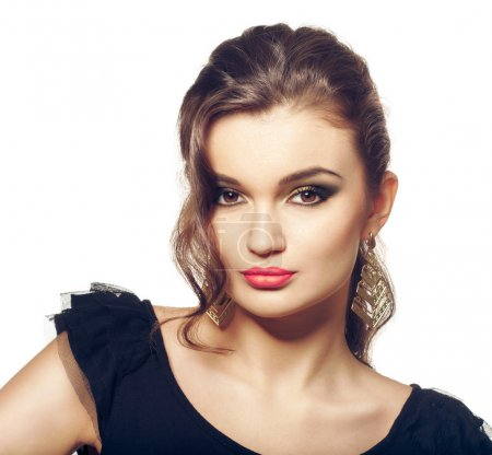 Fashion girl portrait. Evening makeup and hairstyle. Smokey eyes makeup, brown eyes and pink lipstick