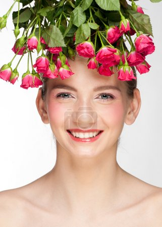 Young beautiful woman with roses