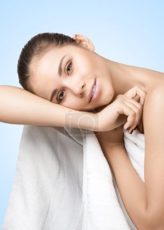 Portrait of pretty young woman with white towel