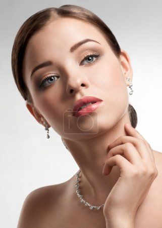Beautiful woman with pearl necklace