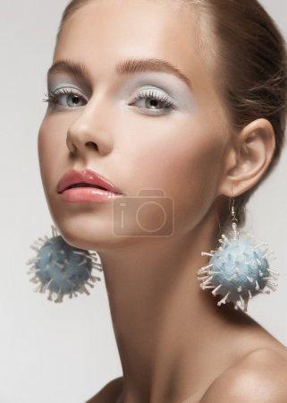 Beautiful woman with fancy earrings