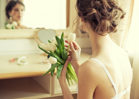 Bride with bouquet of white tulips