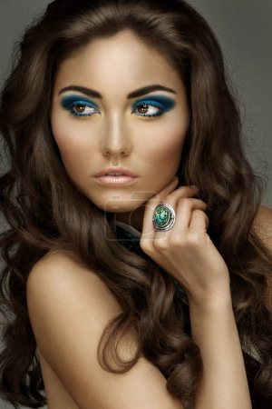 Portrait of young beautiful woman with bright fashion makeup and hairstyle