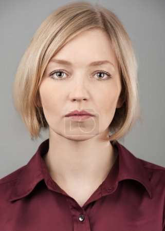Portrait of pretty blond woman with serious face