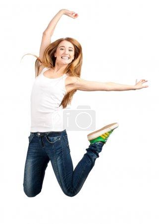 Happy young woman jumping in air
