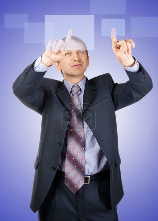 Businessman pressing a touchscreen button