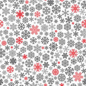 Christmas seamless pattern from red and black snowflakes on white background
