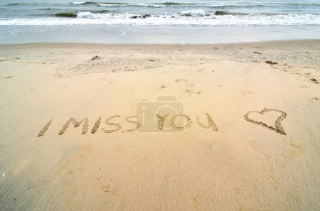 I miss you written on the sand