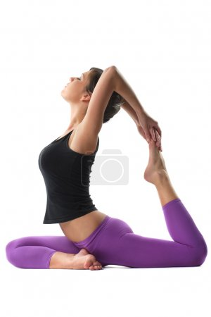 Photo for Young yoga female doing yogatic exericise - Royalty Free Image