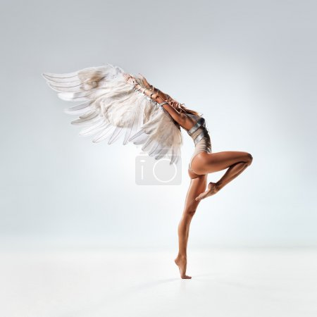 Photo for Young and beautiful dancer posing in studio - Royalty Free Image