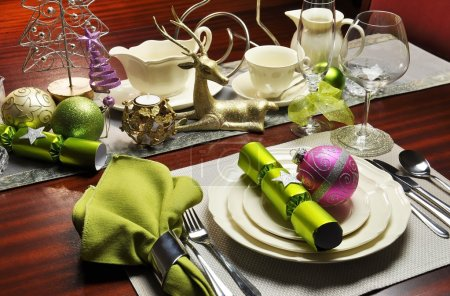 Christmas Eve Green and Pink Dinner Table Setting.