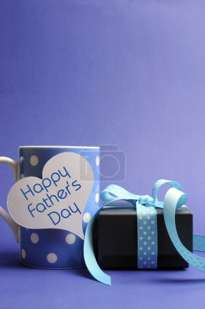 Blue theme polka dot coffee mug and present with Happy Fathers Day message - vertical with copyspace