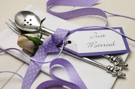 Purple shabby chic wedding table place setting with Just Married tag