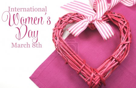 Photo for Happy International Womens Day, March 8, celebration greeting message with pink rattan cane heart and stripe ribbon. - Royalty Free Image